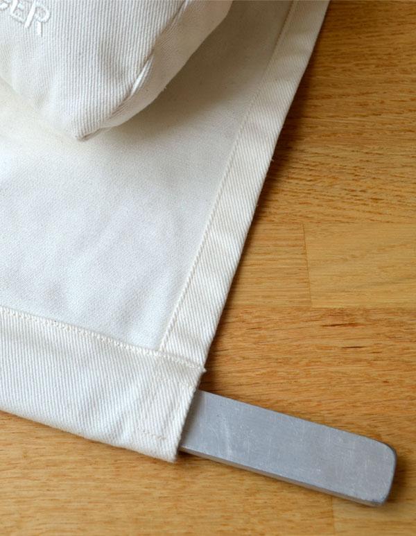 Das Gegengewicht des Nackenkissen wird zum Waschen entfernt